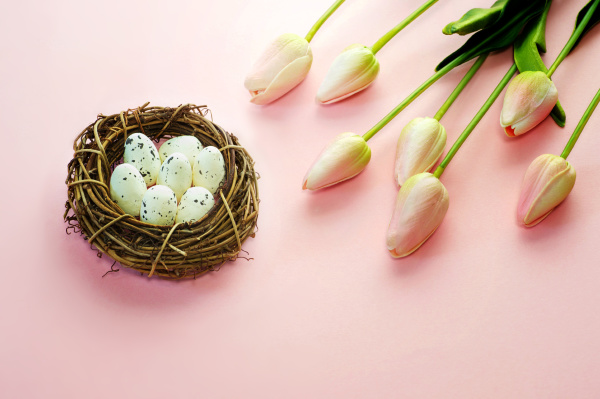 easter eggs and tulips on wooden