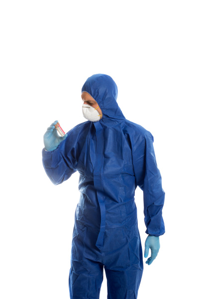 man in protective clothing looking on