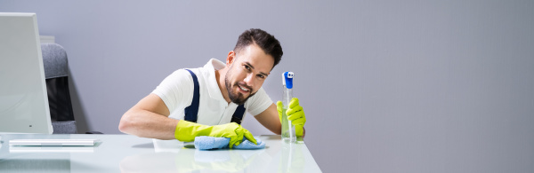 male worker cleaning office