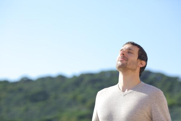 man breathing fresh air near the