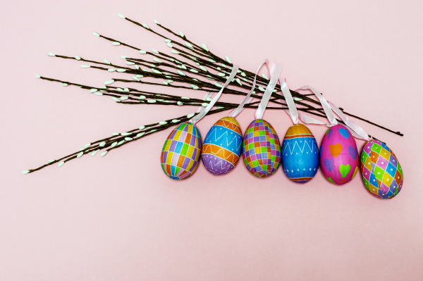paper colorful easter eggs lie on