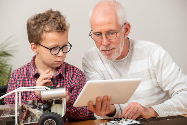 grandpa and son little boy repairing
