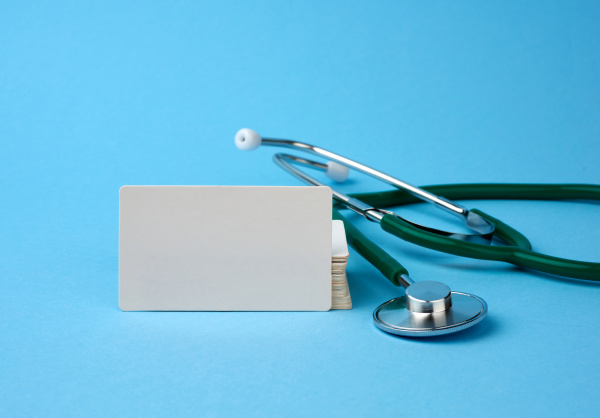 medical stethoscope and empty paper business