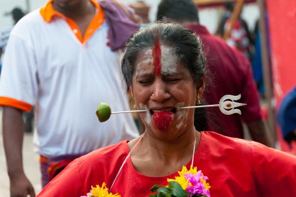 pierced woman in thaipusam festival