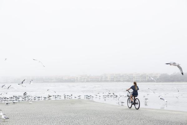 a teenage girl biking on a