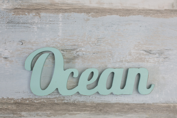 word ocean on wooden background