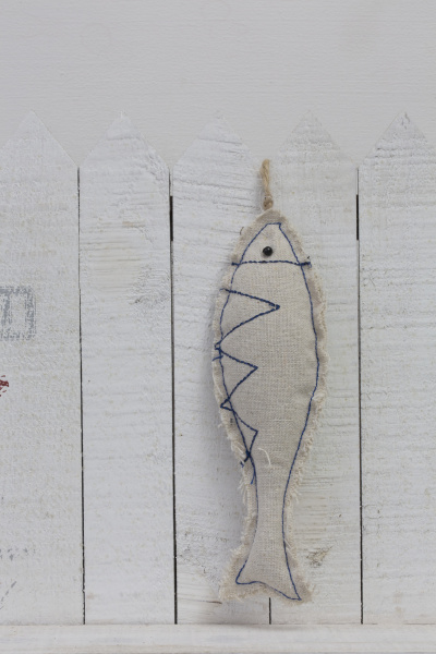 fish hanging from white fence