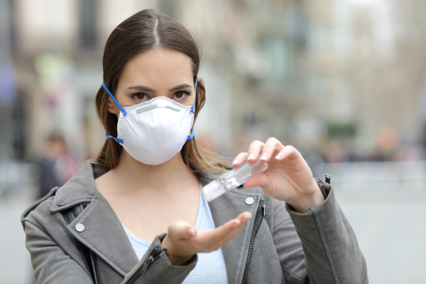 woman with protective mask using hand