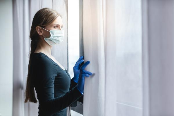 bored woman in corona quarantine looking