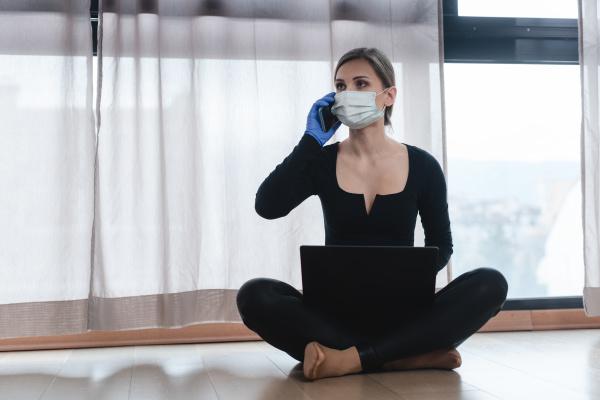 woman in corona quarantine with phone