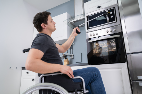 disabled, man, using, grabber, tool, in - 28215141