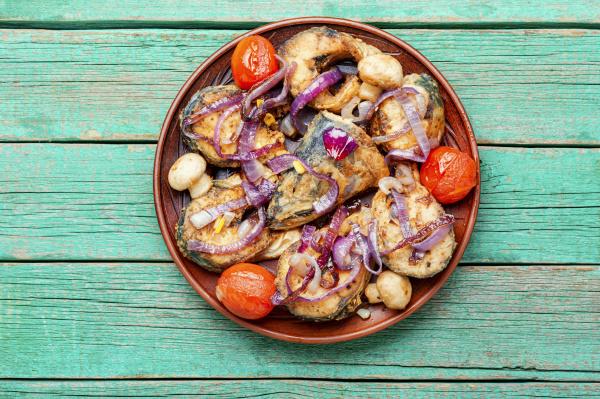 mackerel, fried, in, tomatoes - 28215182