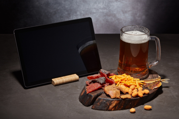 glass mug with beer and snacks