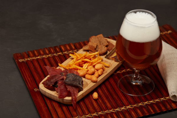 glass with beer and snacks