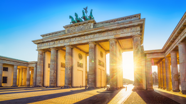the famous brandenburg gate while sunrise