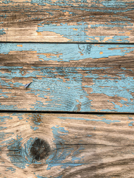 weathered wooden background turquoise and brawn