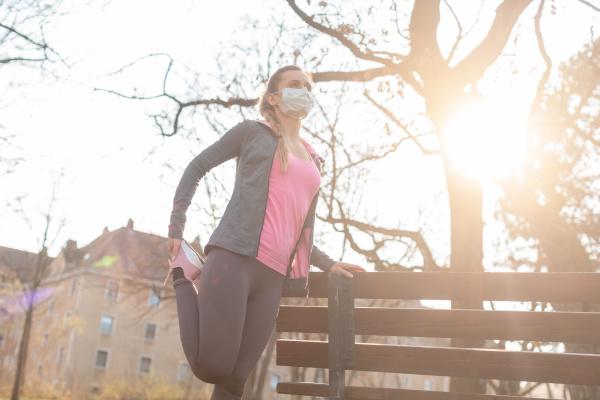 woman during coronavirus crises exercising outdoors