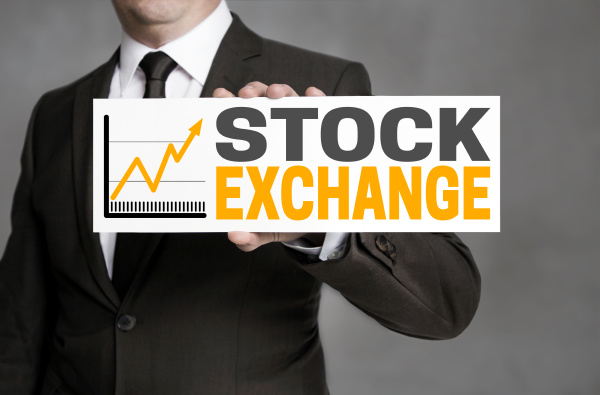 stock exchange sign is held by