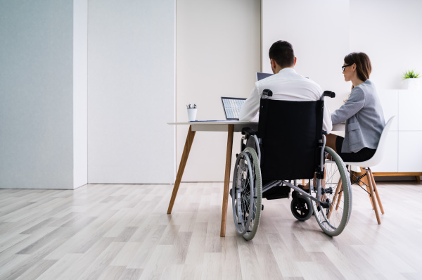 disabled, businesswoman, sitting, with, her, partner - 28237994