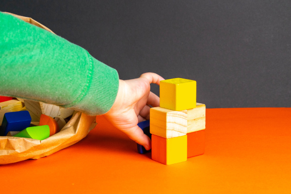 a, child, plays, with, wood, cubes - 28238750