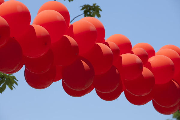 red, balloons, hanging, over, the, street - 28239073