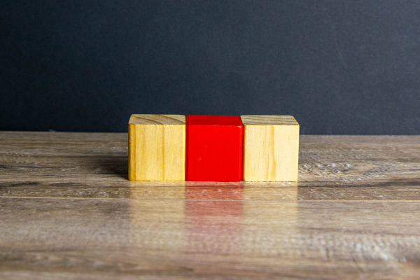 three, wooden, cubes, stand, on, a - 28239350