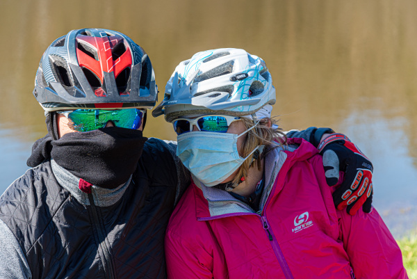 two cyclists protective mask coronavirus