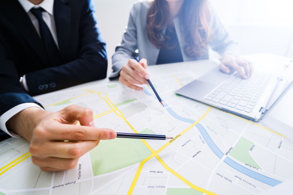two, people, looking, at, city, map - 28240388