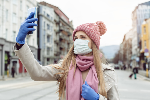 woman with medical mask and gloves