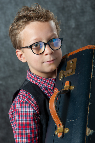 young boy with a suitcase