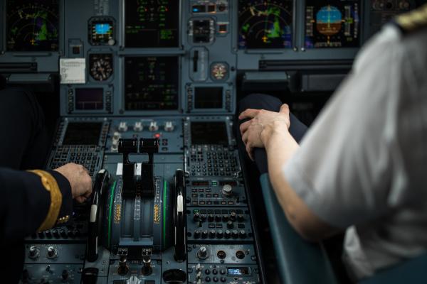 pilots hand dialing in flight values