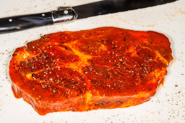 raw marinated pork neck with pepper
