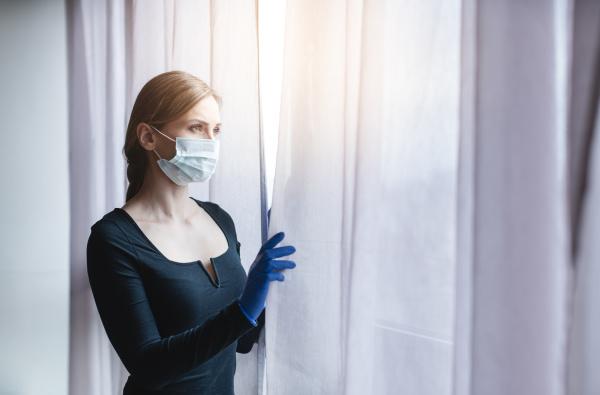 bored woman in corona quarantine or