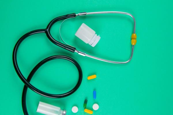 studio shot of stetoscope syringe and