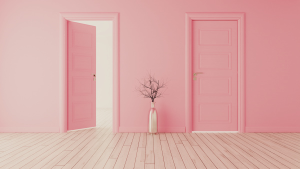 pink wall with pink opened door