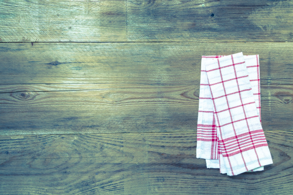 red kitchen towel on rustic wooden