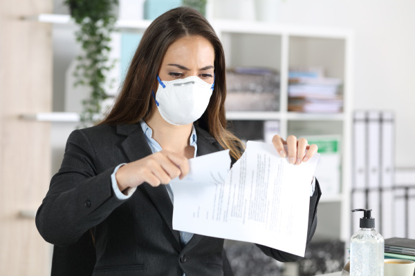 executive with mask breaking contract at