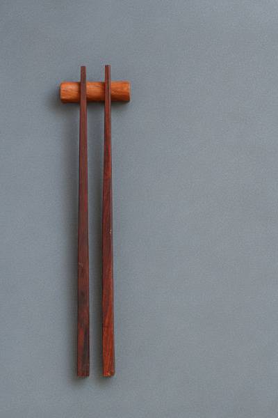 wooden chopsticks on gray background top