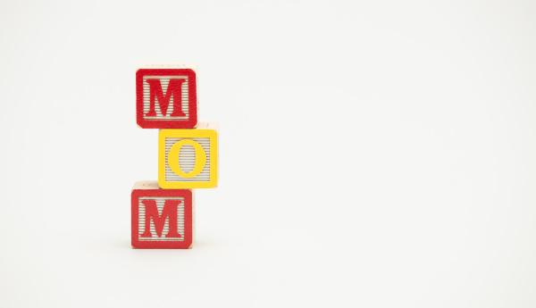 toy blocks spell the word mom