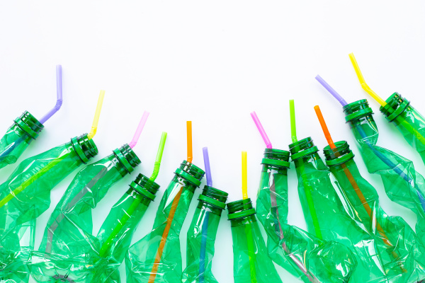 plastic bottles with plastic straws on