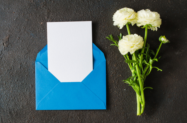 blue envelope with blank white paper