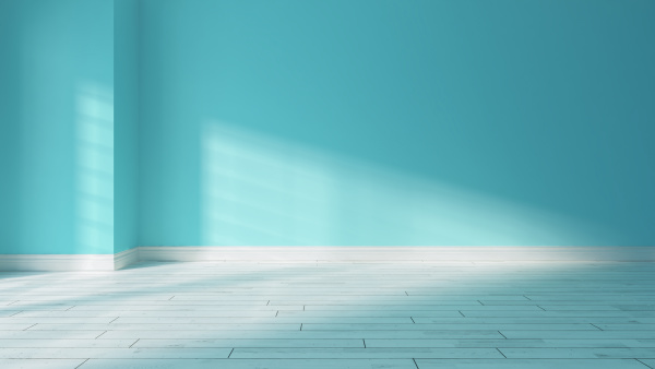 light blue wall and sunlight from