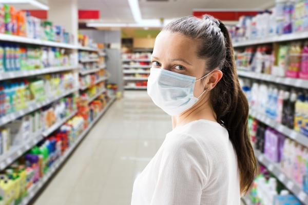 woman shopping wearing face mask