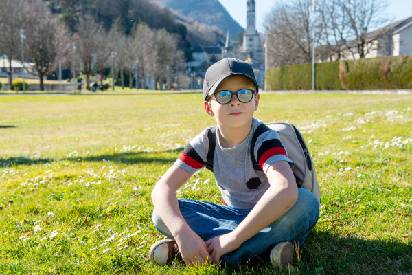 young boy with the basilica of