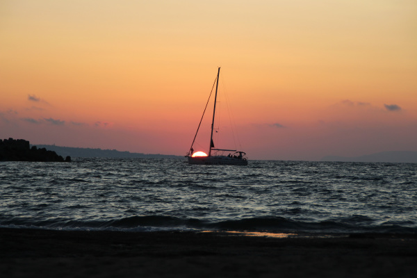 a sailing boat in the sunset