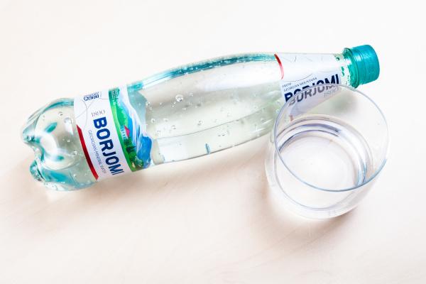 lying bottle of borjomi and glass