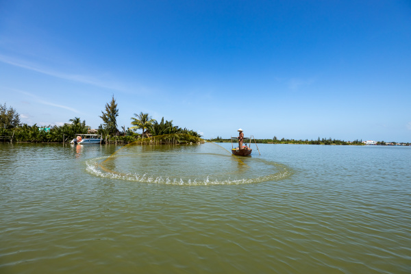 traditional fisherman is fishing in hoi