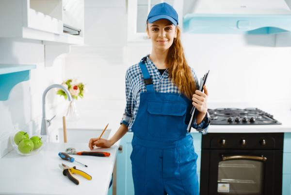 female furniture maker in uniform holds