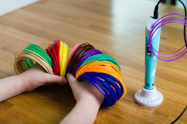 child s hands hold kit colored