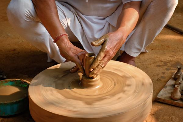 indian potter at work shilpagram udaipur
